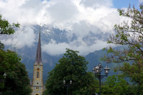 church spire with mountains